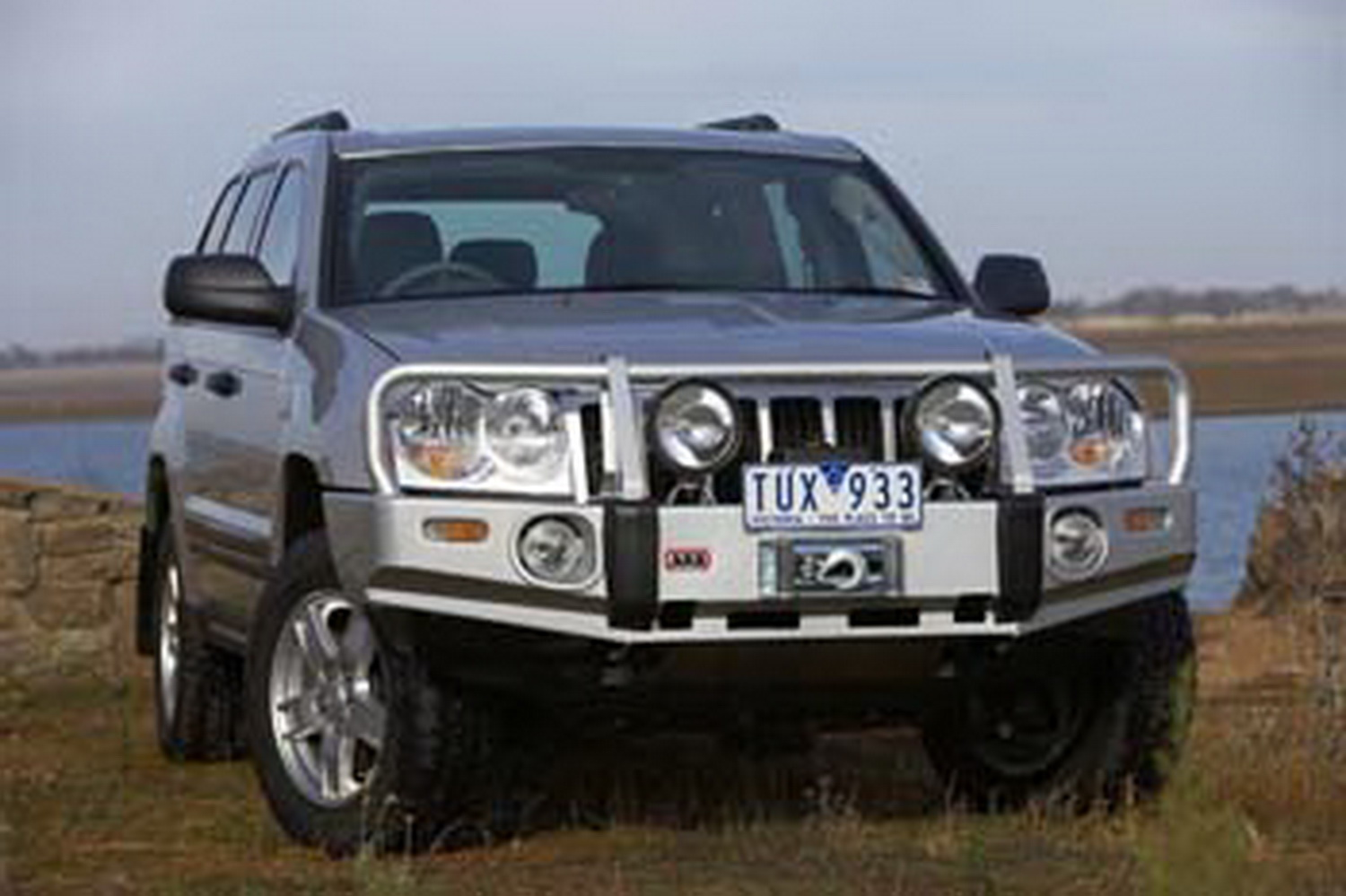 ARB 4x4 Accessories 3450130 Front Deluxe Bull Bar Winch Mount Bumper
